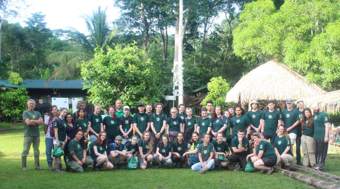 A group of volunteers take a break during their volunteer trip to South America